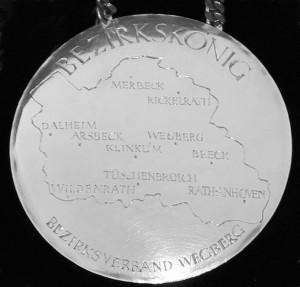 Bezirkskönigsplakette, abgebildet ist der Umriss des Bezirks Wegberg mit den Orten der Bruderschaften